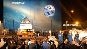 Boeing rolls out Starliner crew capsule at Kennedy Space Center