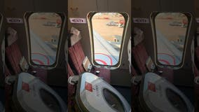 'Crazed' Thai Smile passenger rips plane's emergency exit door open before takeoff