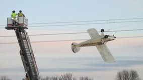 Pilot rescued after plane gets caught in power lines near Shakopee, Minn.