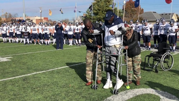 College football player defies the odds to walk on field a year after spinal injury