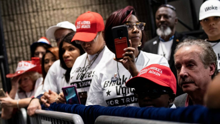 People wait for US President Donald Trump during a rally at the Georgia World Congress Center to court African American votes November 8, 2019, in Atlanta, Georgia. (Photo by Brendan Smialowski / AFP) (Photo by BRENDAN SMIALOWSKI/AFP via Getty Images)