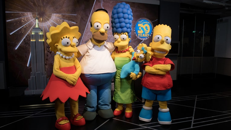 Actors dressed as members of the Simpsons Family in