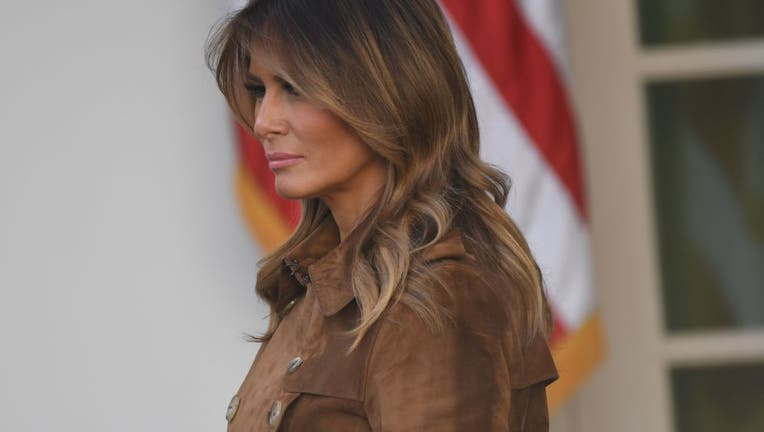 First Lady Melania Trump listens as US President Donald Trump speaks before he pardons the National Thanksgiving Turkey during a ceremony in the Rose Garden of the White House in Washington, DC on November 26, 2019. (Photo by SAUL LOEB / AFP via Getty Images)