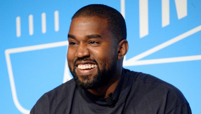 Kanye West speaks on stage at the