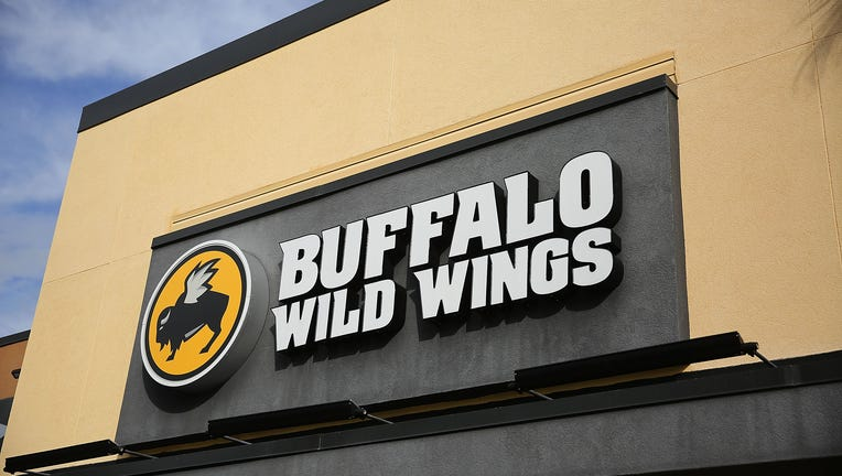 A generic photo of a sign above a Buffalo Wild Wings restaurant
