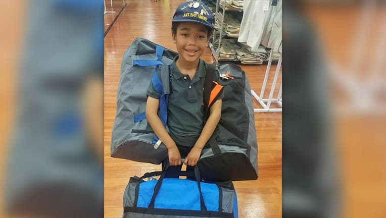 Tyler Stallings, 8, has been helping homeless veterans with
