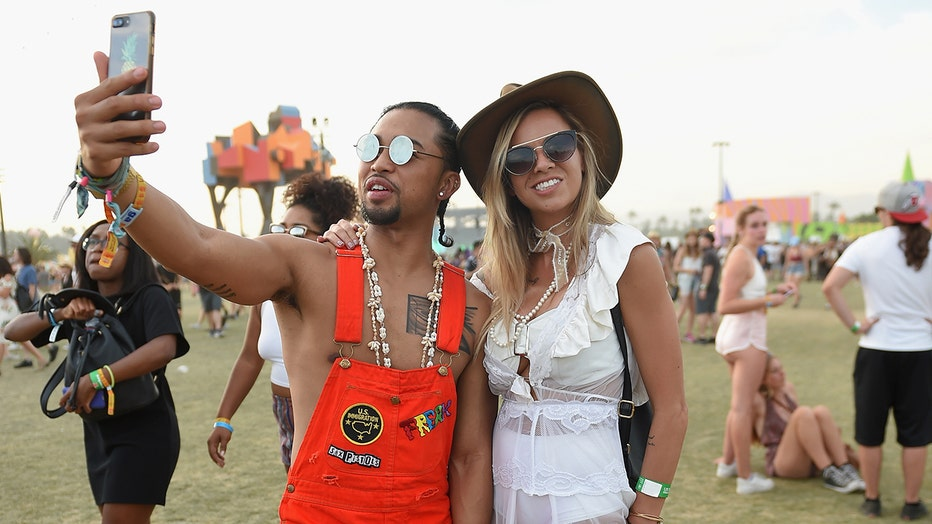Festivalgoers pose for a selfie at Coachella Music and Arts Festival 2017. Such expressions of self-confidence have been labeled narcissism by some, but new research argues there are benefits to sub-clinical narcissism.