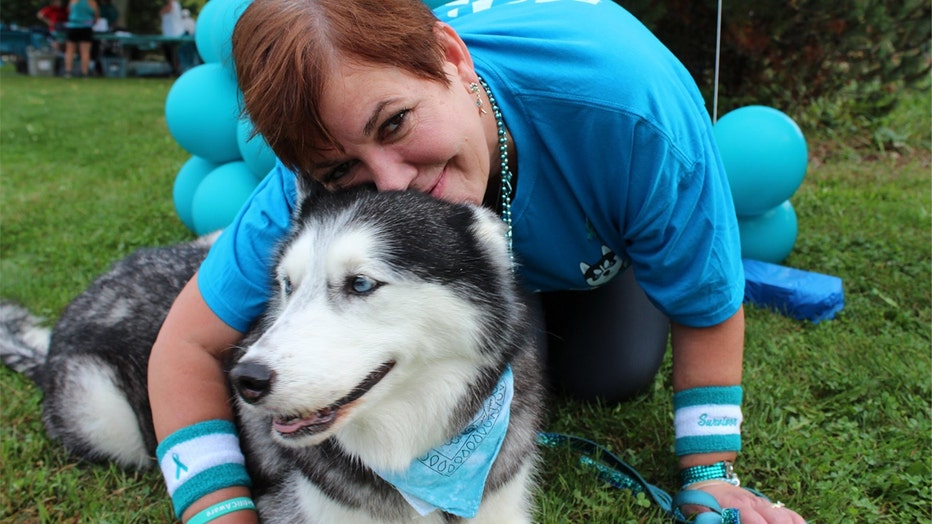 Stephanie Herfel with her husky, Sierra, who discovers Herfel's ovarian cancer re-occurrences before doctors can.