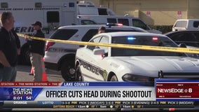Officer cuts head during shootout