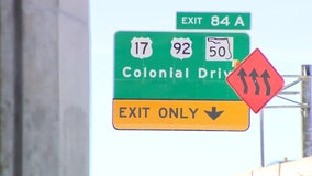 Westbound I-4 exit at Colonial Drive shifts from right to left side of road
