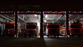 Fire engines put on festive light display to 'Carol of the Bells'