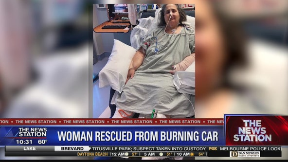 Woman saved from burning car on the road to recovery