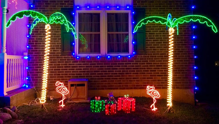 Christmas tree lights with palm trees and flamingos.