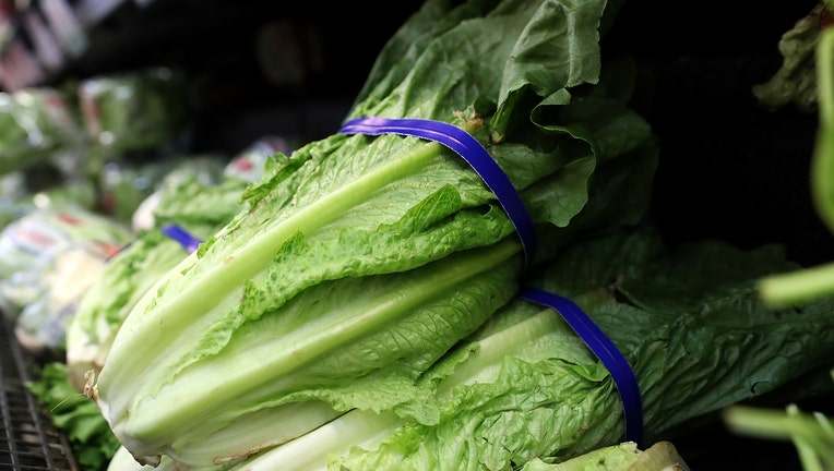 FILE - Romaine lettuce is displayed on a shelf at a supermarket.