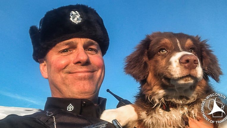 Trooper Jones and River, the dog he helped locate after its owner got in a car crash.