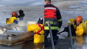 Police and firefighters rescue dog trapped in icy pond