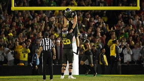 Herbert has 3 TD runs, Oregon beats Wisconsin in Rose Bowl