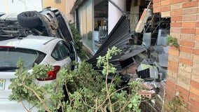 Two cars crash into Daytona Beach business causing extensive damage