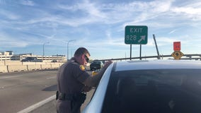 FOX 35 follows FHP as they pull over drivers for breaking new texting and driving law