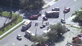2 injured, roadway shutdown after crash in Orlando