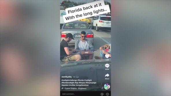 Viral TikTok video shows men playing cards while waiting at Florida intersection