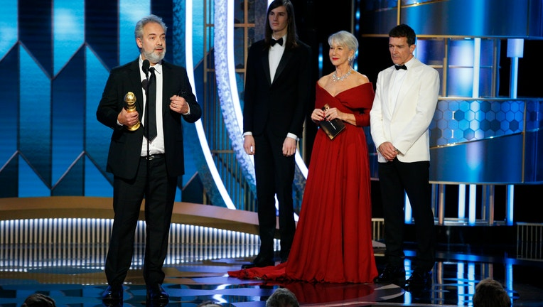 BEVERLY HILLS, CALIFORNIA - JANUARY 05: In this handout photo provided by NBCUniversal Media, LLC, Sam Mendes accepts the award for BEST DIRECTOR - MOTION PICTURE for