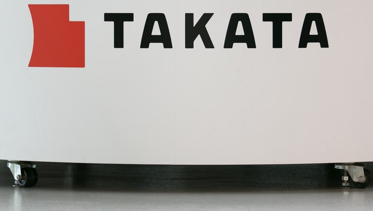 A Takata Corp. logo is seen on display at a car showroom in Tokyo, Japan.