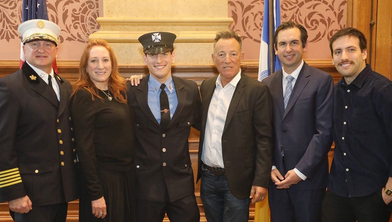 Sam Springsteen (third from left) poses with his parents Patti Scialfa and Bruce Springsteen, Mayor Steven Fulop, and others at City Hall in Jersey City, N.J., Jan. 14, 2020.