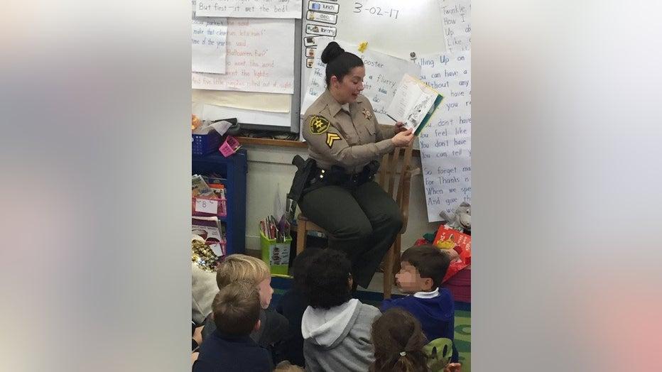 Detective-Amber-Leist-reading-to-kids.jpg