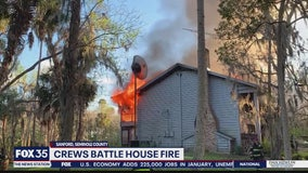 Firefighters battle flames in Sanford home containing ammunition