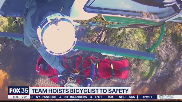 Team hoists bicyclist to safety