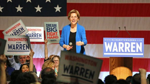 Elizabeth Warren rallies packed Seattle crowd, slams Mike Bloomberg