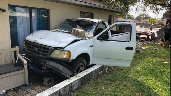 Truck crashes through wall into backyard of Brevard County home