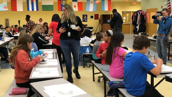 Tildenville Elementary students learn about STEM careers by building 'chocolate asphalt'