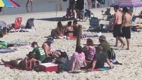 New Smyrna Beach packed with people despite coronavirus outbreak, push to keep distance from others