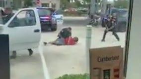 Takedown video shows police arresting Melbourne murder suspect