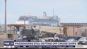 Passengers continue to disembark from ships at Port Everglades