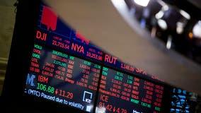 Stocks tumble as unemployment spikes on coronavirus layoffs