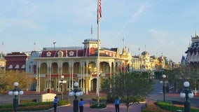 Disney cast members raise American flag inside empty Magic Kingdom