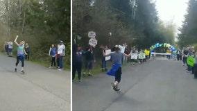 Teacher runs solo marathon with socially distanced supporters after Boston Marathon postponement