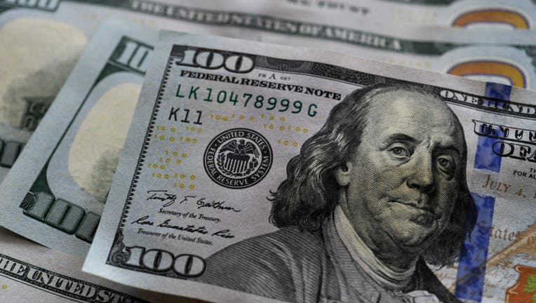 In this photo illustration $100 banknotes are seen displayed.