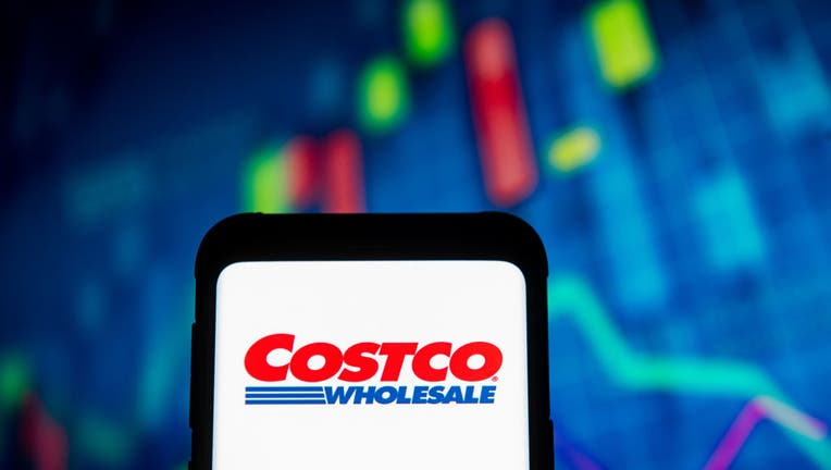 In this photo illustration, a Costco Wholesale logo seen displayed on a smartphone.