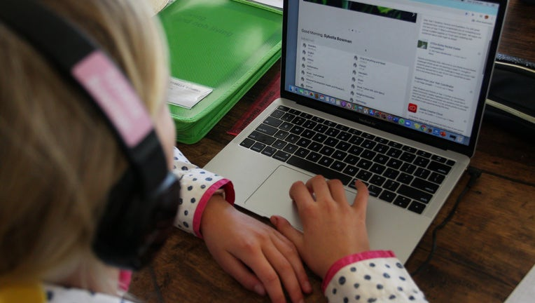 getty (file home school) Rural Parents Struggle With Internet Infrastructure As They Home School Children During Coronavirus Lockdown