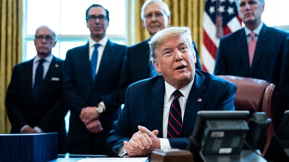193ece0b-President Trump Signs Coronavirus Stimulus Bill In The Oval Office
