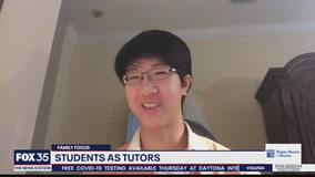 Students helping parents with distance learning as tutors