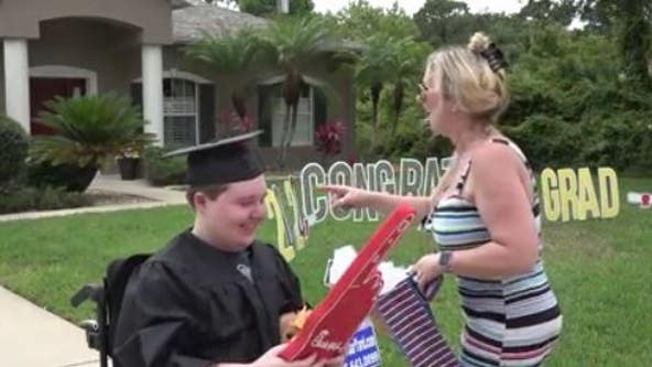 High school senior with compromised immune system surprised by drive-by graduation parade