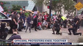 Orlando police officers, protesters kneel together