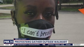 Protesters gather outside Walmart