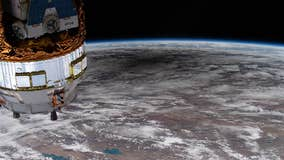 Spacewalking astronaut loses mirror, newest space junk