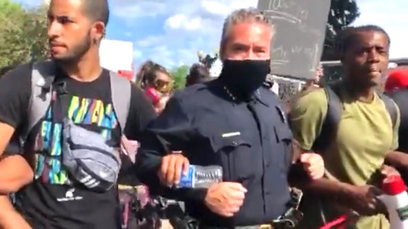 Video shows Denver police chief marching arm-in-arm with protesters at George Floyd demonstration